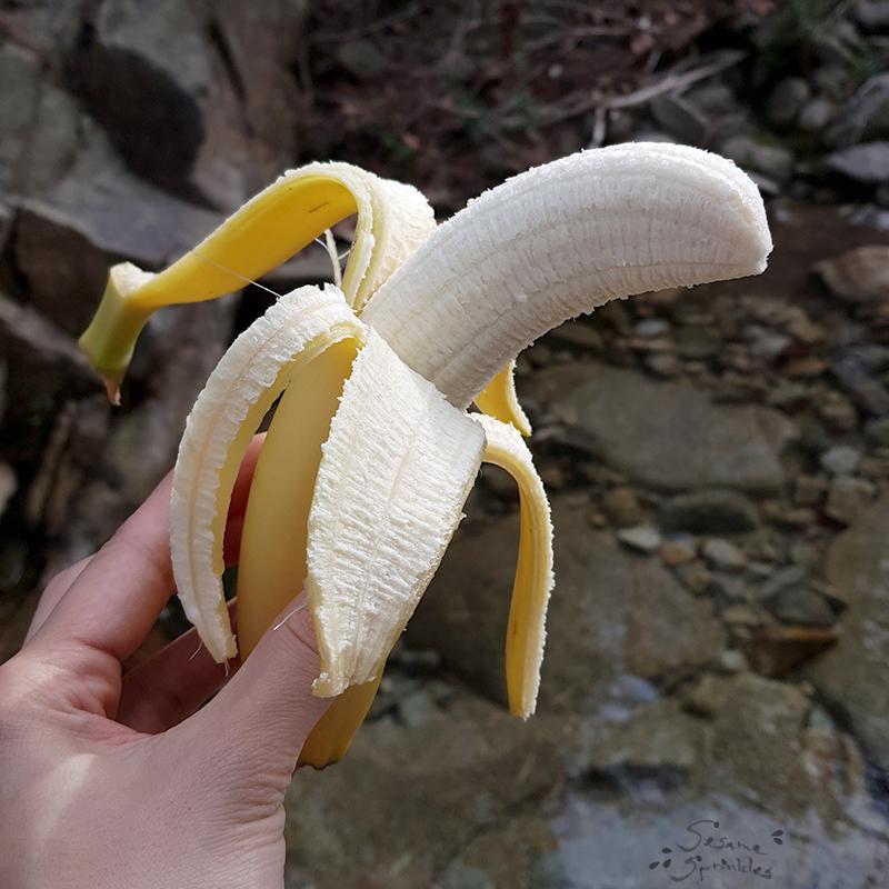 Peeled banana enjoyed during a hike.