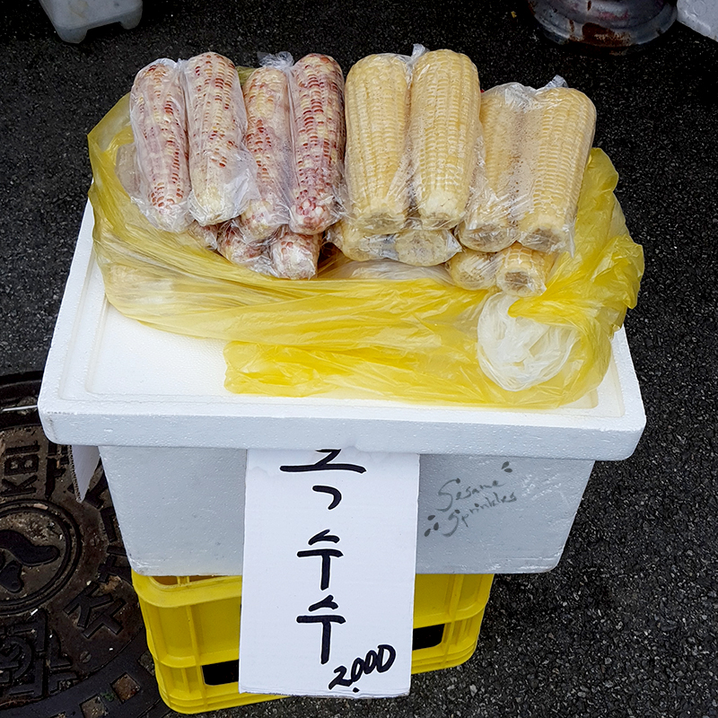 Steamed corn sold by a street vendor.